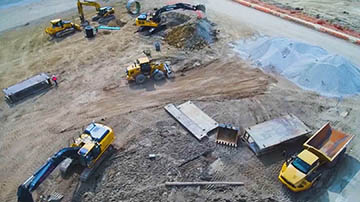 Overhead wide angle shot of construction site with multiple vehicles