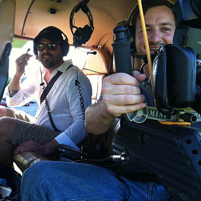 Cameraman and Director in helicopter fo video shoot