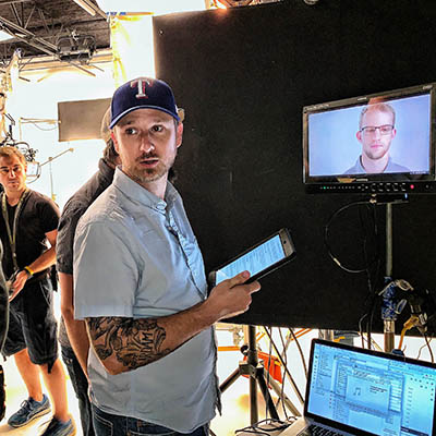 Director Joe Harris at monitor for All About Vision video content shoot