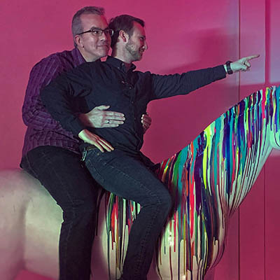 Shelby Miller and Joe Harris on a unicorn at Rainbow Vomit in Dallas